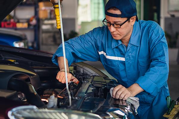 car mechanic checking and repair customer car at garage and maitenance station